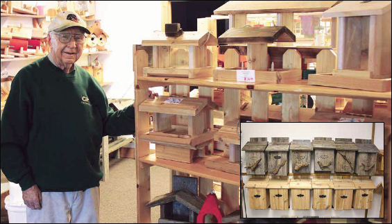 Gordon Seimers stands next to bird feeders of his creation at his Crosslake store, Birds, Bats and Beyond. The store also sells Siemers' bat houses (above inset).